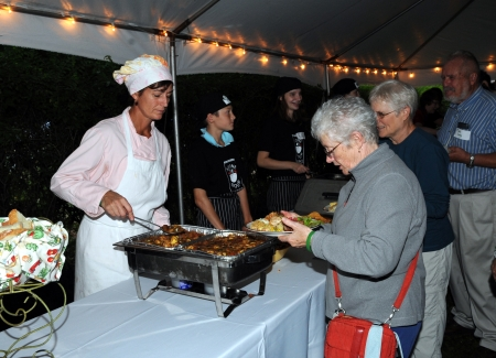 Jennifer Verrill-Faddoul serves food during the first Stone Soup Dinner in 2008.