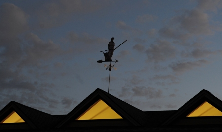 The new weathervane sits atop our farm stand.