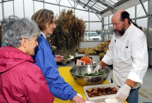 "Henrietta's Table chef/owner Peter Davis dishes out samples during Saturday's ""Chef Fest and Book Signing."""